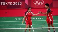 Setelah melewati laga yang sengit dan menegangkan akhirnya wakil Indonesia itu menyudahi laga dengan kemenangan 24-22 dan 21-19.(Foto: AFP/Pedro Pardo)