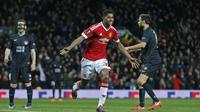 Striker Manchester United Marcus Rashford  merayakan gol ke gawang Mitdjylland pada leg kedua babak 32 besar Liga Europa. (Liputan6.com/Reuters / Russell Cheyne Livepic)