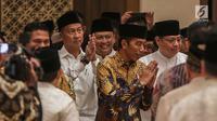 Presiden Joko Widodo (Jokowi) tiba untuk menghadiri acara Buka Puasa Bersama Partai Golkar, di Jakarta, Minggu (19/5/2019). Kegiatan tersebut mengangkat tema Menjemput Kemenangan Ramadan. (Liputan6.com/Faizal Fanani)
