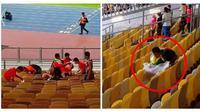 Suporter Myanmar tetap memunguti sampah meski timnya dibungkam Malaysia 3-0 pada laga pamungkas Grup A Piala AFF 2018. (AFF Suzuki Cup)