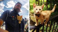 Pengendara motor menyelamatkan seekor anak kucing yang terluka, dan membawa si kucing dalam perjalanan mengendarai sepeda motor.