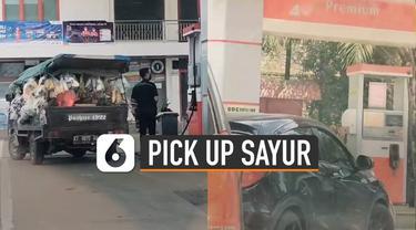 kejadian unik terjadi ketika mobil pick up berisi sayur mengisi bahan bakar pertamax dan mobil mewah justru antri mengisi bahan bakar premium.