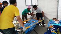 RS Terapung 'Ksatria Airlangga' tangani tiga korban gempa Lombok. (Liputan6.com/Fitri Haryanti Harsono)