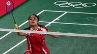 Tunggal putri Indonesia, Gregoria Mariska Tunjung, menang mudah atas wakil Myanmar, Thet Htar Thuzar, dengan skor 21-11, 21-8 pada laga pembuka Olimpiade 2020. (AFP/Pedro