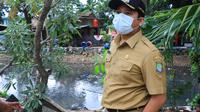Wali Kota Tangerang Arief R. Wismansyah memantau kondisi wilayhnya jelang memasuki musim hujan. (Liputan6.com/Pramita Tristiawati)