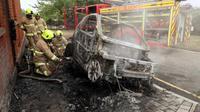 Mobil listrik kebakar (Foto:Telegraph)