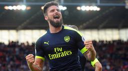 2. Olivier Giroud – Giroud merupakan striker yang memiliki finishing yang brilian. Selama berseragam Arsenal Giroud berhasil mengemas 69 gol dan 27 assists dalam 164 laga. (EPA/Rui Viera)