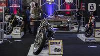 Aneka kendaraan dipamerkan di IIMS Hybrid 2021, JiExpo Kemayoran, Jakarta, Jumat (16/4/2021).  Pemerintah memberikan prioritas terhadap pengembangan industri otomotif agar bisa lebih berdaya saing global sesuai dengan sasaran pada peta jalan Making Indonesia 4.0. (Liputan6.com/Johan Tallo)