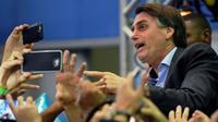 Jair Bolsonaro, politikus Brasil yang dinilai memiliki sikap rasis seperti Presiden Donald Trump (AFP)