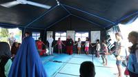 Anak-anak koban gempa dan tsunami di Palu menjalani  psikososial di Dinsos Palu (Liputan6.com/Moch Harun)