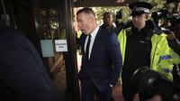 Pemain Everton, Wayne Rooney saat hadir pada pengadilan Stockport Magistrates di Stockport, Inggris, (18/9/2017). Kehadiran Rooney di pengadilan karena kedapatan mengemudi saat mabuk. (Peter Byrne/PA via AP)