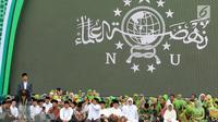 Presiden Joko Widodo atau Jokowi memberi sambutan dalam Harlah ke-73 Muslimat NU di SUGBK, Jakarta, Minggu (27/1). Jokowi juga berpesan agar tetap menjaga persaudaraan menghadapi Pemilu 2019. (Liputan6.com/Johan Tallo)