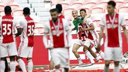 Pemain Ajax Amsterdam, Antony Matheus Dos Santos dan David Neres, melakukan selebrasi usai memastikan diri meraih gelar juara Liga Belanda usai mencukur Emmen 4-0 dalam laga pekan ke-31 di Stadion Johan Cruijff Arena, Minggu (2/5/2021). (AFP/Maurice Va Steen)
