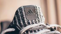 Ilustrasi produk Adidas. (dok. unsplash @tec_razy)