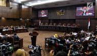 Suasana sidang perdana sengketa Pilpres 2019 di Mahkamah Konstitusi (MK), Jakarta, Jumat (14/6/2019). Sesuai jadwal, persidangan hari ini dengan agenda pembacaan materi gugatan dari pemohon, yaitu paslon 02 Prabowo Subianto-Sandiaga Uno. (Lputan6.com/Johan Tallo)