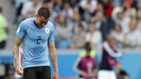 Ekspresi kesedihan bek Timnas Urugua, Jose Maria Gimenez saat melawan Prancis pada perempat final Piala Dunia 2018. (AP Photo/Ricardo Mazalan)