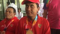 Pecatur putra Indonesia, Hendi Wirawan, berhasil meraih dua medali emas dari nomor perorangan dan beregu putra catur standar B1 Asian Para Games 2018. (Bola.com/Benediktus Gerendo)