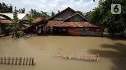 Banjir merendam rumah warga di Desa Sindangsari, Kabupaten Bekasi, Jawa Barat, Rabu (24/2/2021). Sebagian rumah warga masih terendam banjir yang disebabkan jebolnya tanggul Sungai Citarum dan luapan Sungai Ciherang. (merdeka.com/Imam Buhori)