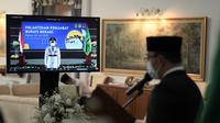 Gubernur Jabar Ridwan Kamil saat melantik Kepala Pelaksana BPBD Jabar Dani Ramdan sebagai Penjabat (Pj) Bupati Bekasi via konferensi video dari Gedung Pakuan, Kota Bandung, Kamis (22/7/2021). (Foto: Biro Adpim Jabar)