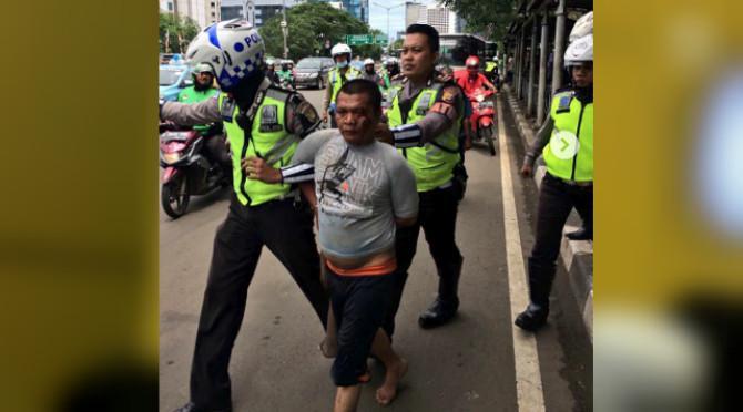 Seorang pria diduga akan serang polantas di Sudirman (Instagram TMC Polda Metro Jaya)
