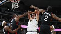 Nikola Jokic (no15) membantu Nuggets menang atas Raptors di ajanG NBA (AP)