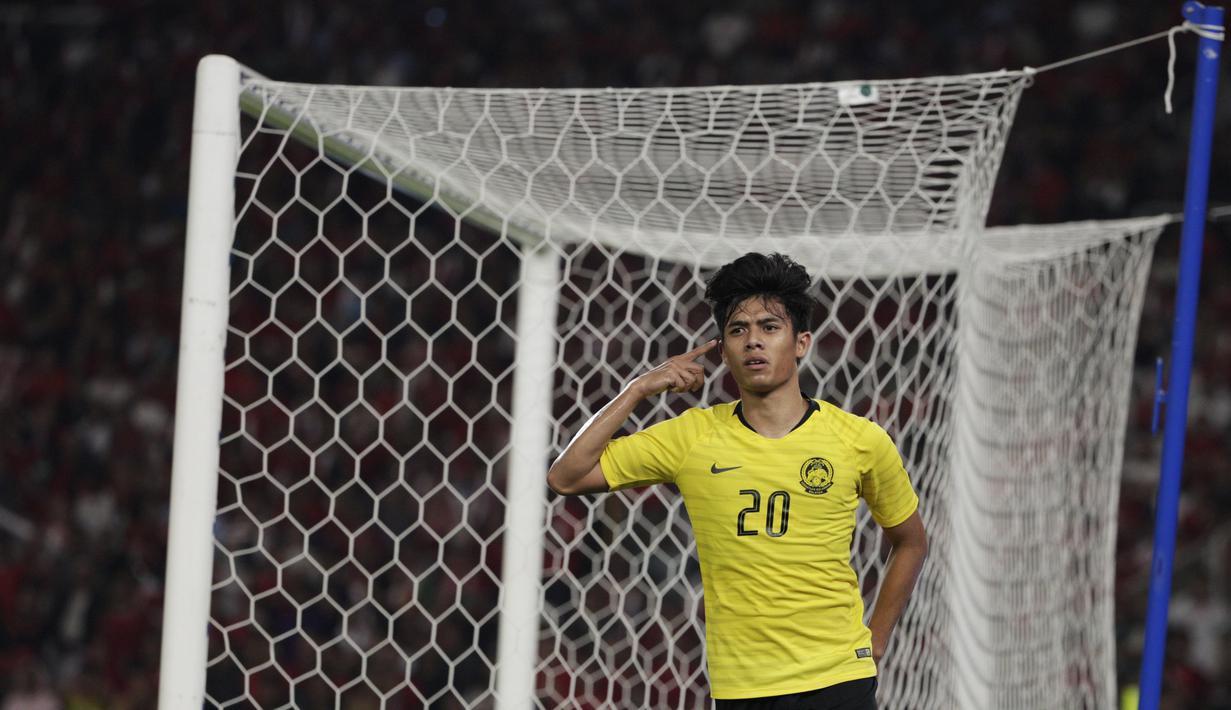 Striker Malaysia, Muhammad Syafiq, merayakan gol yang dicetaknya ke gawang Timnas Indonesia pada laga Kualifikasi Piala Dunia 2022 di SUGBK, Jakarta, Kamis (5/9). Indonesia kalah 2-3 dari Malaysia. (Bola.com/Vitalis Yogi Trisna)