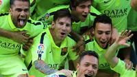 Lionel Messi rayakan gelar juara di Vicente Calderon (CESAR MANSO / AFP)