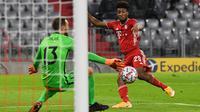 Kingsley Coman ketika membobol gawang Atletico Madrid. Bayern Munchen menang 4-0. (ANDREAS GEBERT / POOL / AFP)
