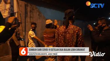 Joko Santoso adalah pasien Covid-19 yang dinyatakan sembuh pada Selasa malam. Pria berusia 52 tahun ini disambut meriah warga Desa Bendung, Kecamatan Jetis, Mojokerto. Ia juga diarak keliling desa dan menemui warga sebelum pulang ke rumahnya.