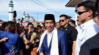 Presiden Jokowi saat berkunjung ke Pondok Pesantren Babussalam di Kampung Besilam, Kecamatan Padang Tualang, Kabupaten Langkat, Sumatera Utara. (Liputan6.com/Reza Efendi)