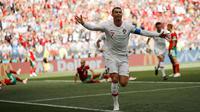 Penyerang Portugal, Cristiano Ronaldo berselebrasi usai mencetak gol ke gawang Maroko pada lanjutan grup B Piala Dunia 2018 di Stadion Luzhniki di Moskow, Rusia (20/6). Ronaldo telah mencetak 4 gol selama turnamen ini. (AP Photo / Francisco Seco)