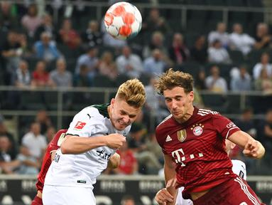 Bayern Muncih gagal berikan kemenangan di laga pembuka Liga Jerman usai ditahan imbang oleh Moenchengladbach. Tuan rumah mampu merepotkan juara bertahan Liga Jerman musim 2020/2021. (Foto: AFP/Ina Fassbender)