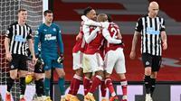 Pierre-Emerick Aubameyang berhasil mencetak dua gol sekaligus membawa Arsenal menang 3-0 atas Newcastle United pada laga pekan ke-19 Premier League di Stadion Emirates, Selasa (19/1/2021) dini hari WIB. (Shaun Botterill/POOL/AFP)