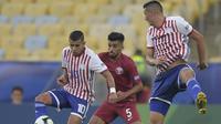 Timnas Paraguay bermain imbang  1-1 melawan Qatar pada laga Grup B Copa America 2019, di Stadion Maracana, Rio de Janeiro, Senin (17/6/2019) pagi WIB. (AFP/Carl De Souza)