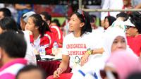 Atlet lari andalan Indonesia, Dedeh Erawati hadir pada peluncuran logo Asian Games 18th di Senayan, Jakarta, Sabtu (27/12/2015). (Bola.com/Nicklas Hanoatubun)