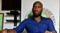 6. Didier Drogba - Prestasinya tidak hanya bagi Chelsea di dunia sepakbola namun juga di dunia politik usai berkontrubusi dalam perdamaian pasca konflik yang terjadi di Pantai Gading. (AFP/Issouf Sanogo)