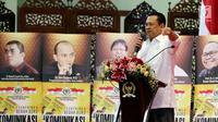 Ketua DPR Bambang Soesatyo atau Bamsoet memberi sambutan dalam peluncuran buku Komunikasi Politik Jokowi di Jakarta, Jumat (9/3). Buku tersebut mengupas bahasa komunikasi politik Presiden Jokowi. (Liputan6.com/JohanTallo)