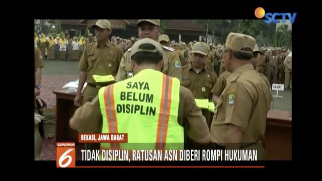 Ratusan ASN Pemkot Bekasi diberi sanksi mengenakan rompi hukuman karena kerap membolos dan tak disiplin.