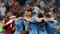 Pelatih Timnas Portugal, Oscar Tabarez, menyebut timnya sempat kesulitan meladeni permainan ngotot yang ditunjukkan Portugal. (AFP/Adrian Dennis)