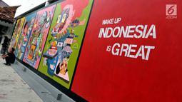Suasana di pameran street art atau yang biasa di kenal dengan sebutan Mural karya senimanYogyakarta yang bertajuk INDONESIA IS GREAT di museum Galeri Nasional, Jakarta, Sabtu (22/7). (Liputan6.com/Helmi Afandi)