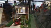 Sebuah miniatur rumah pada pameran properti Mandiri Fiesta Expo di Jakarta, Selasa (12/11/2019). Pameran ini juga menawarkan promo diskon 20 persen premi Asuransi dan free e-Money untuk nasabah Mandiri Group dan nasabah Sinar Mas Land yang mengajukan KPR. (Liputan6.com/Angga Yuniar)