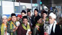 Jemaah umrah asal Indonesia yang dipulangkan lebih awal karena terdampak kebijakan penangguhan sementara akses masuk ke Arab Saudi, Sabtu (29/2/2020). (Ist)