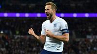 Striker Inggris, Harry Kane, mencetak hattrick ke gawang Montenegro pada laga Kualifikasi Piala Eropa 2020 di Stadion Wembley, London, Jumat (15/11/2019). (AFP/Glyn Kirk)