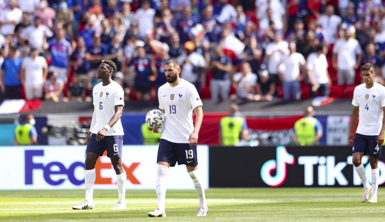 Prancis harus puas dengan hasil imbang ketika menghadapi tuan rumah Hongaria di Stadion Puskas Arena, Budapest, Hongaria. Mereka harus kebobolan terlebih dahulu sebelum Antoine Griezmann berhasil samakan kedudukan. (Foto: AP/Pool/Alex Pantling)