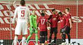 Para pemain Manchester United merayakan gol yang dicetak oleh Marcus Rashford ke gawang RB Leipzig pada laga Liga Champions di Stadion Old Trafford, Kamis (29/10/2020). MU menang dengan skor 5-0. (AP/Dave Thompson)