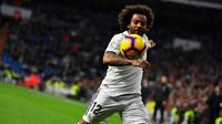 Bek Real Madrid, Marcelo, menegaskan sama sekali tak berniat untuk hengkang ke klub lain pada bursa transfer musim panas tahun ini. (AFP/GABRIEL BOUYS)