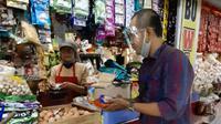 Bayu Santosa (37), seorang Mantri BRI yang ikut andil dalam pengembangan Web Pasar di Pasar Basah Dinoyo.