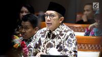Menteri Agama Lukman Hakim Saifuddin saat raker dengan Komisi VIII DPR di Gedung DPR, Jakarta, Kamis (16/5/2019). Rapat membahas kebijakan Rancangan Peraturan Pemerintah tentang Jaminan Produk Halal dan revisi Biaya Penyelenggaraan Ibadah Haji (BPIH) 1440 H/2019 M. (Liputan6.com/JohanTallo)