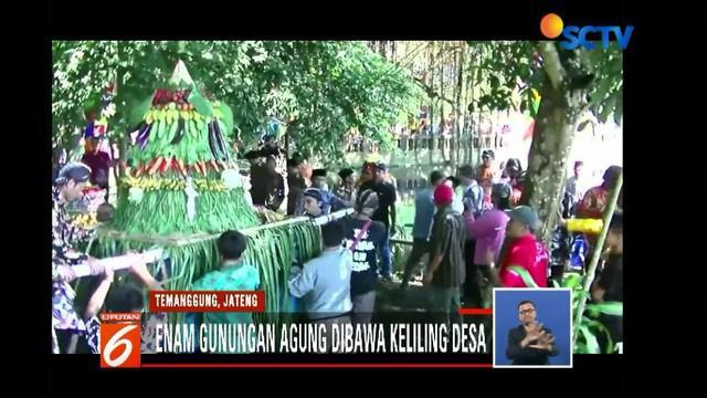 Warga Temanggung, Jawa Tengah, gelar tradisi Grebeg Lepen Telogo Bambu dengan kirab enam gunungan agung berisi hasil bumi sebagai rasa syukur.