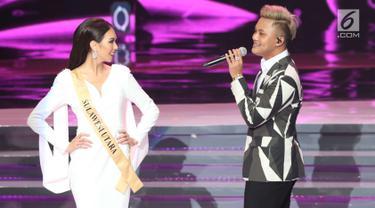 Penyanyi Rizky Febian saat tampil pada malam final Miss Grand Indonesia 2018 di JCC Jakarta, Sabtu (21/7). Rizky Febian membawakan dua lagu pada malam final. (Liputan6.com/Angga Yuniar)